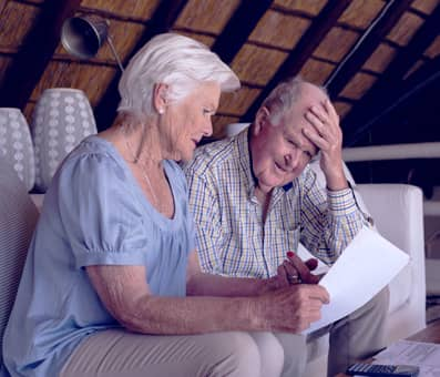 elderly couple struggling with their mortgage